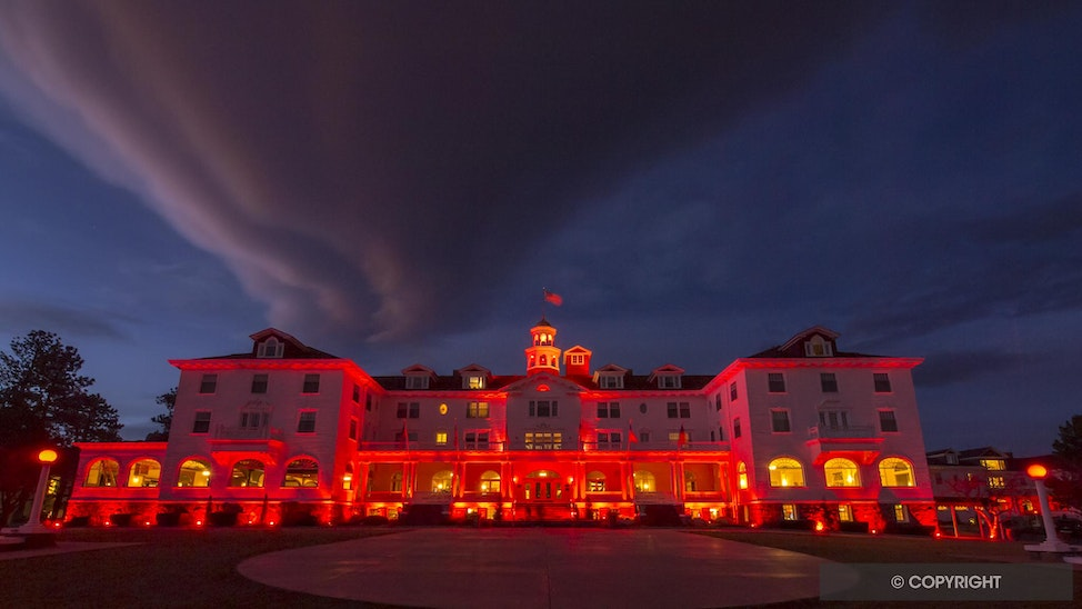 Halloween Hotel - Lit with red lights for Halloween the Stanley Hotel, Estes Park, Colorado, shows how it could inspire Stephen KIng's The Shining