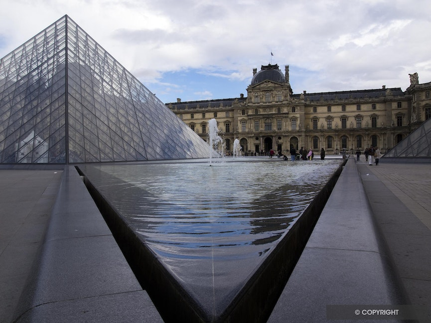 Inverted Pyramids - The I. M. Pei pyramid entrance to the Louvre Museum inverted by the reflecting fountain