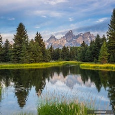 Grand Teton National Park - Rising abruptly from the Jackson Hole valley, the Teton Range contains some the oldest rocks in North America, yet is one of...