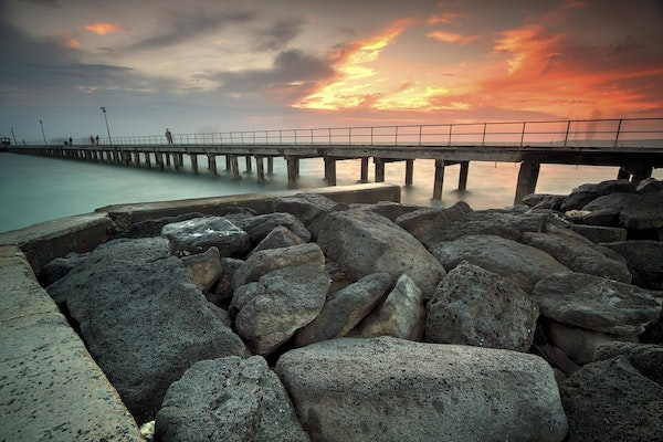On the rocks. - Taken at Mordialloc pier, showing the sunset in the background.