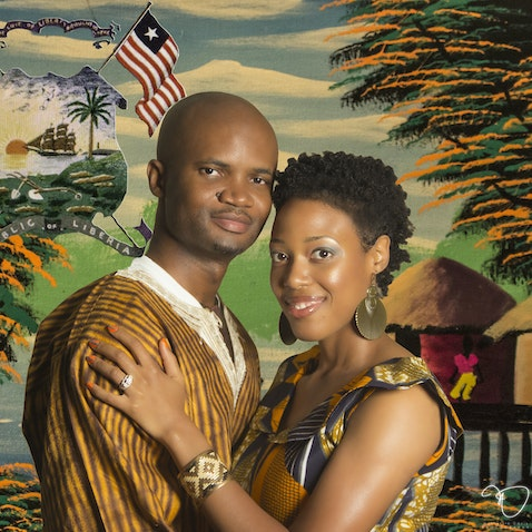 Engagement Shoot Portrait - Liberian Scene Superimposed in the back of studio session with couple.