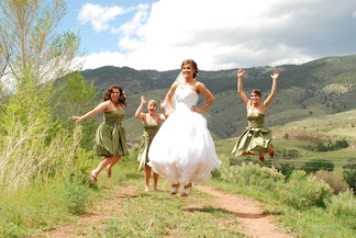 Brides maids jump in wedding photo