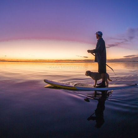 Sunrise paddle, Moreton Bay - Best friends paddle together as the sun rises over Moreton Bay.