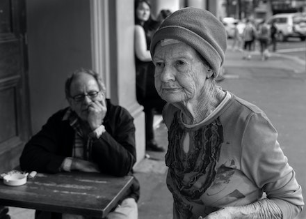Newtown Street Walk 098-Edit - Lady in the street and admirer looking on, Newtown, Sydney, Australia.