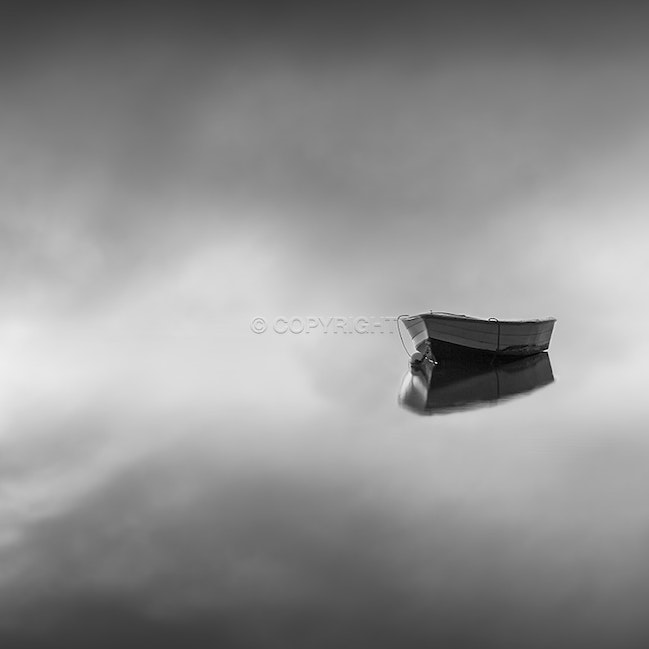 Adrift - A boat appears out of the fog over the bay one surreal morning.