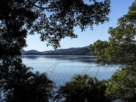 Touching the Mountain - Peaceful view out over the waters of Lake Wivenhoe, Esk, Queensland on a Spring afternoon.