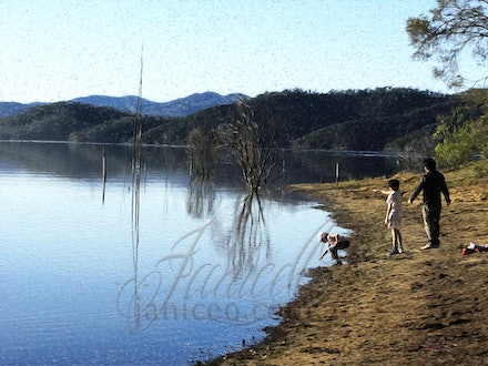Water's Edge - A family visiting the sandy shores of Lake Wivenhoe dam in the Brisbane Valley, South east Queensland.