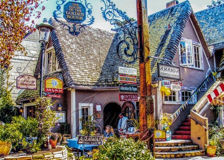 Lunch Time - A small cafe in a group of shops in the small seaside village of Carmel, California, USA. A waiter waits patiently to seat customers as a...