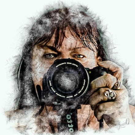 The Photographer - A self portrait - taken through a mirror. A pencil and charcoal overlayed in washed colours from the image beneath bring up the features....