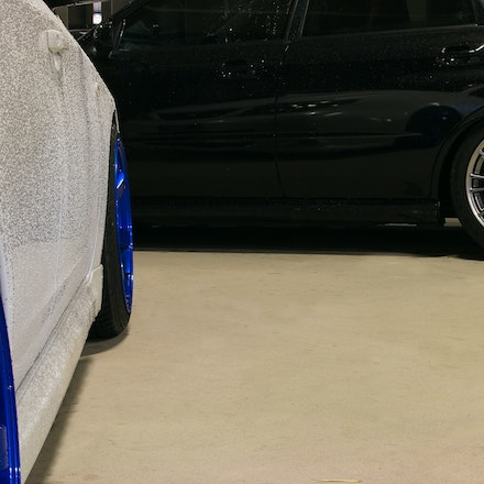 Reflections - The reflection of Sean's WRX Hatch in Nick's WRX STi