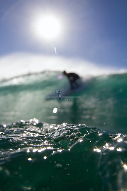 Double Bubble - The bubbles look on, as a lone surfer takes the morning drop.