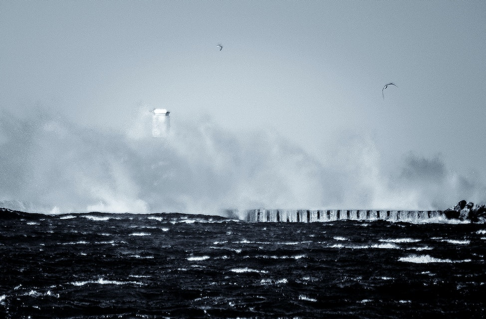 The Big Finish - Waves crash and rise over lighthouse.