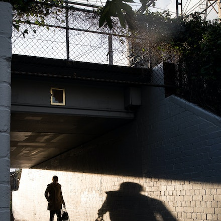 Abbotsford - Victoria Park Station Underpass - City of Yarra Project - A shadowy figure walks through the Victoria Park Station underpass, Abbotsford