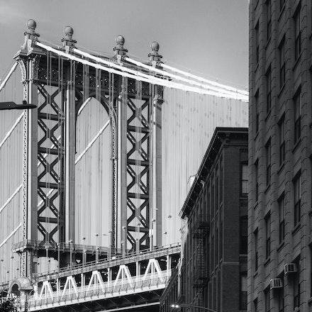 NYC - Manhattan Bridge_Empire State Building - The Empire State Building viewed through the base of the Manhattan Bridge in Brooklyn