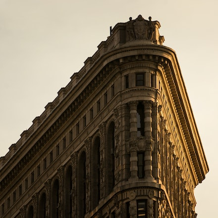 NYC - Flatiron Building Detail Shot - The top of the Flatiron Building in beautiful golden New York light