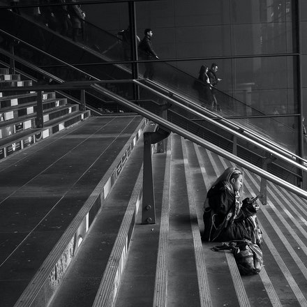 Southern Cross Station - A girl sits on the steps at Southern Cross railway station, Melbourne