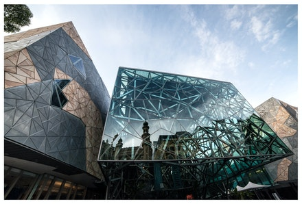 Federation Square Reflecting The Forum - The Forum Theatre reflected in in the glass of Federation Square, Melbourne. Priced from $15 for standard lustre...