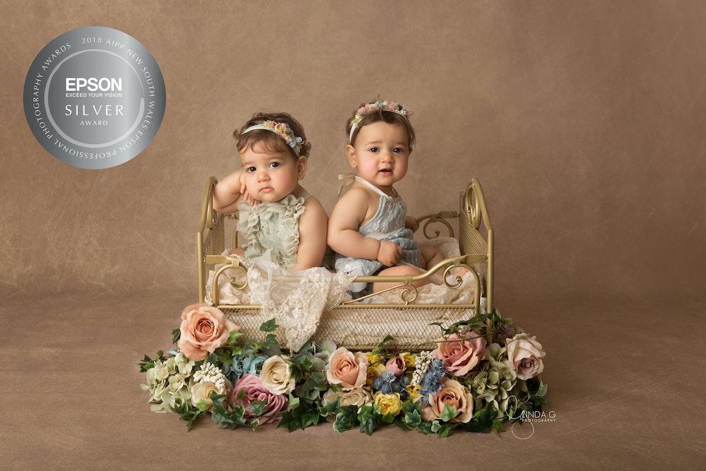 Amalia and Rosa Silver Award - award winning baby photographer