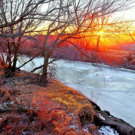 Frozen River - Dusty setting sun shining over the Big Blue River in Saline County, Nebraska