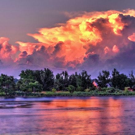 Thunderstorm - An early evening shot of a mid-summer thunderstorm viewed across the Platte River south of Columbus, Nebraska