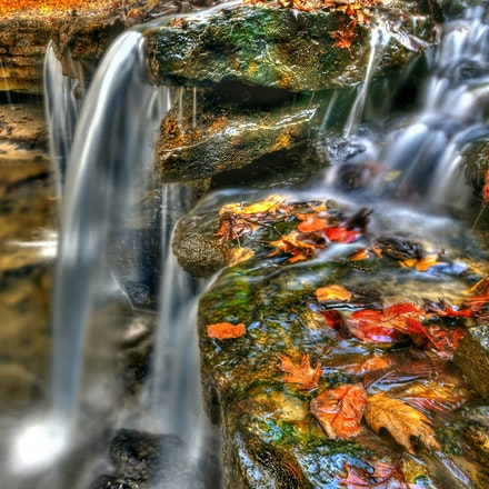 The Snakehead - An autumn side shot of the falls at Platte River State park.  This is a long exposure of the falls utilizing a ND filter which allows for...