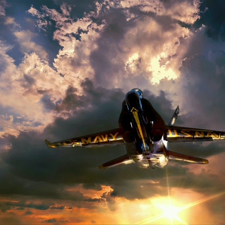 Outta the Sun  5.8.2016.17 - Outta the Sun.  The gold letters on the underside of this f18 Hornet are lit up by the rays from the setting Nebraska sun....