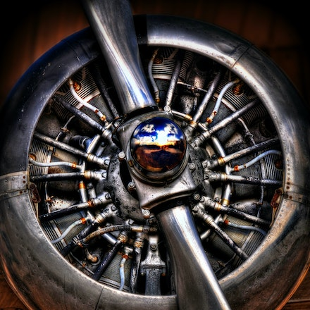 Radial Engine   6.1.2016.6 - Radial Engine. A blue South Dakota sky dotted with clouds reflects off this airplane propeller at Ellsworth Air Force Base....