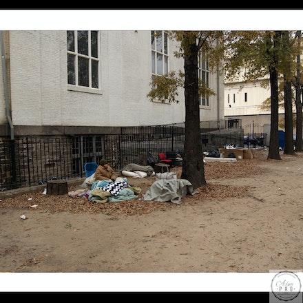 Homeless lady Beside church