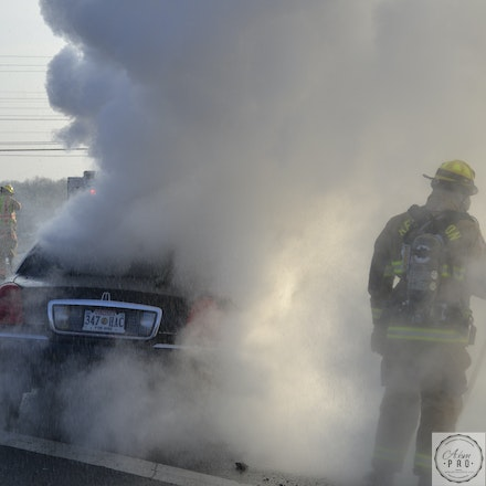 A Firefighter Steps Into The Smoke - 495 Capitol Beltway, USA, Dec. 13 2014: A firefighter moves in to fight a fire.