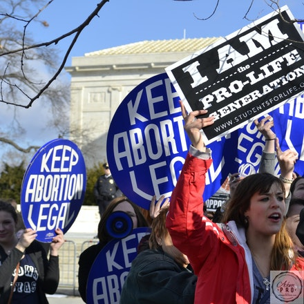 I Am The Pro-Life Generation. - U.S. Supreme Court. Washington, D.C., USA, Jan 22, 2015: A young Pro-Life demonstrator holds her ground surrounded by Pro-Choice...