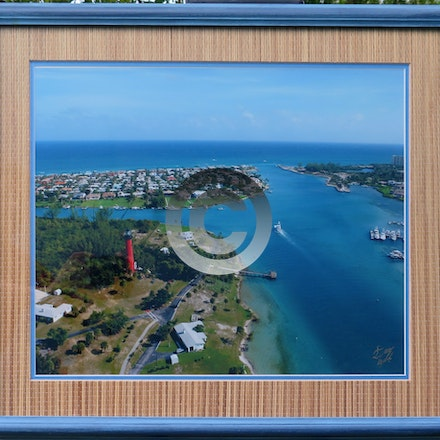 JUPITER INLET - This Aerial is double matted with a hand made rattan mat to match the blue beveled frame. $125.00, can be picked up, local delivery or...