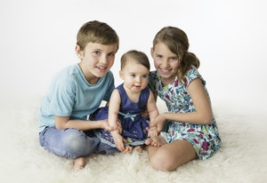 siblings with baby