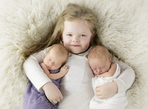 Newborn twins with sister
