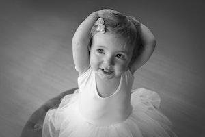 toddler in white tutu