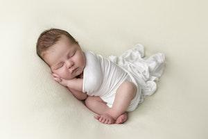 Baby boy in white wrap