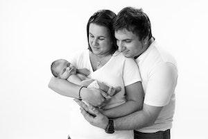 newborn family portrait of 3