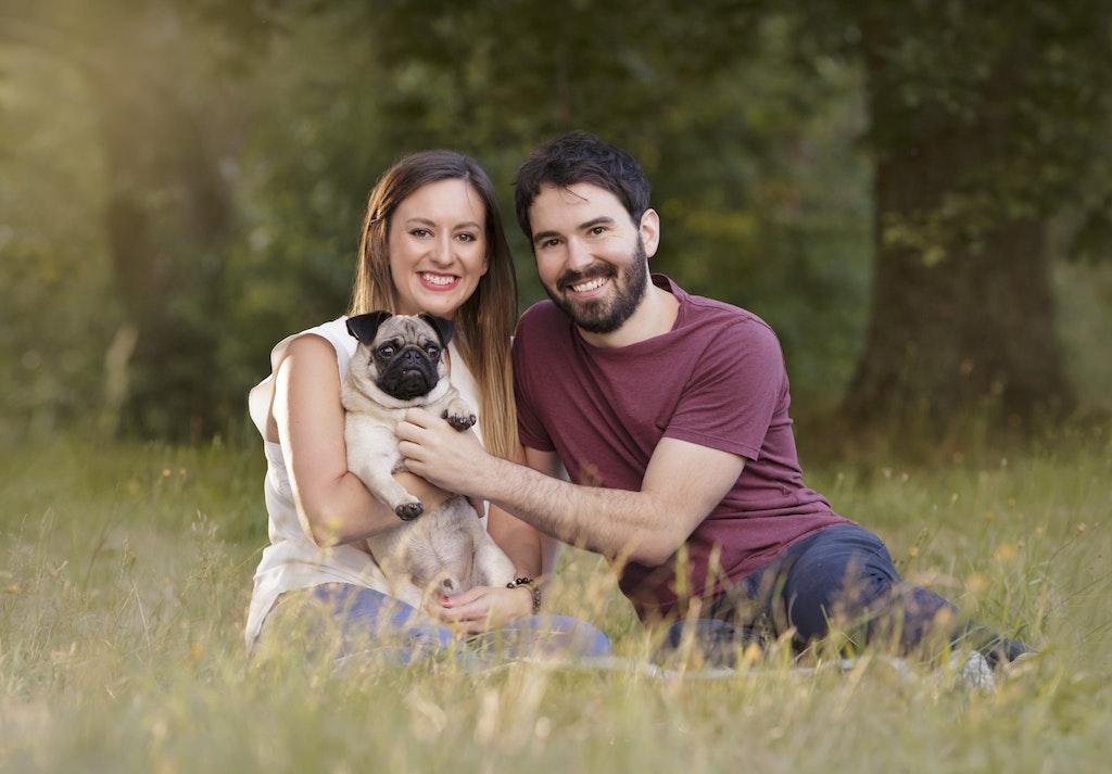 couple with pug dog