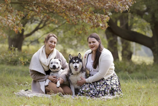 sisters with beloved dogs