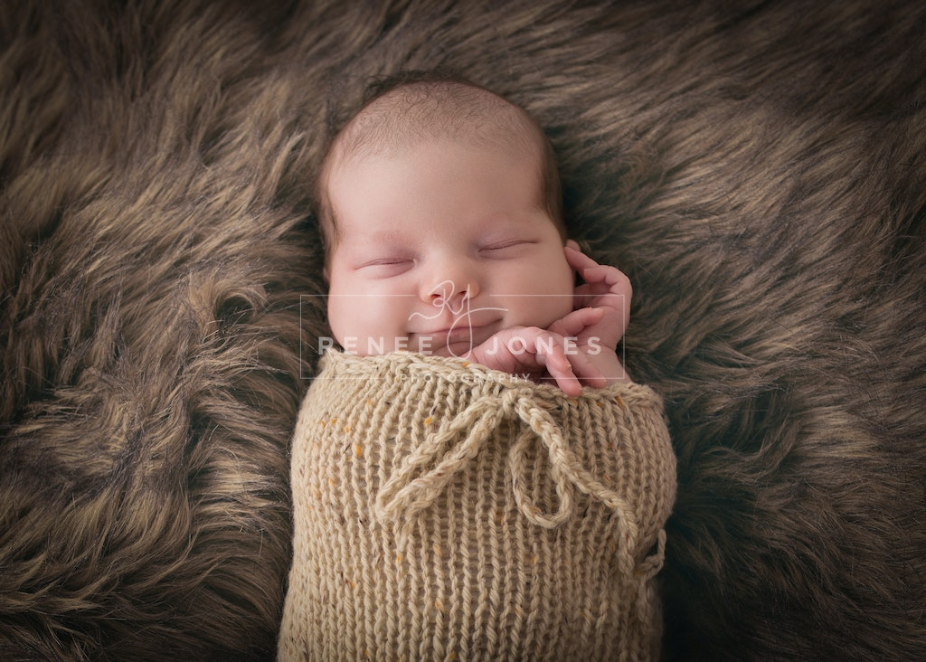 Baby, that smile! - Gorgeous smiling baby in a knitted sleep sack.