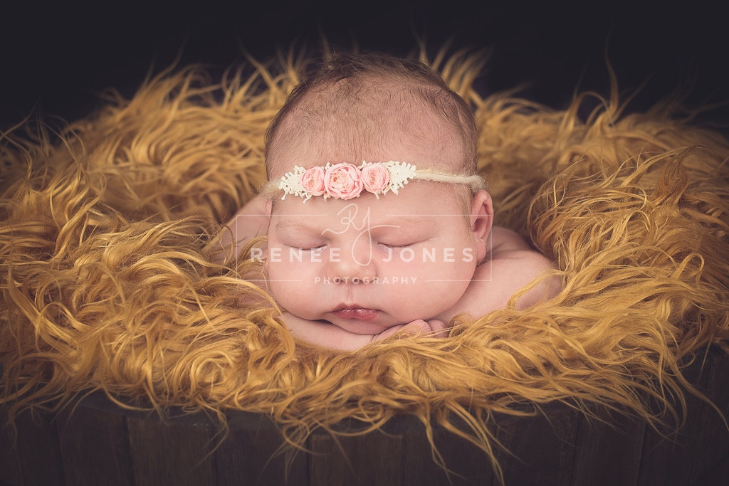 Baby Girl - Gorgeous girl sleeping with her head resting on her hands.
