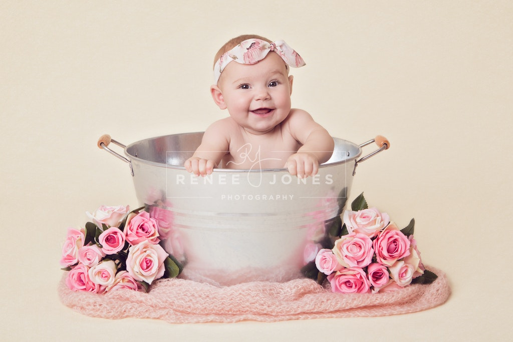 5 month milestone portrait - Brisbane Baby Photographer - 5 month old baby girl sitting in a metal tub at her milestone portrait session.