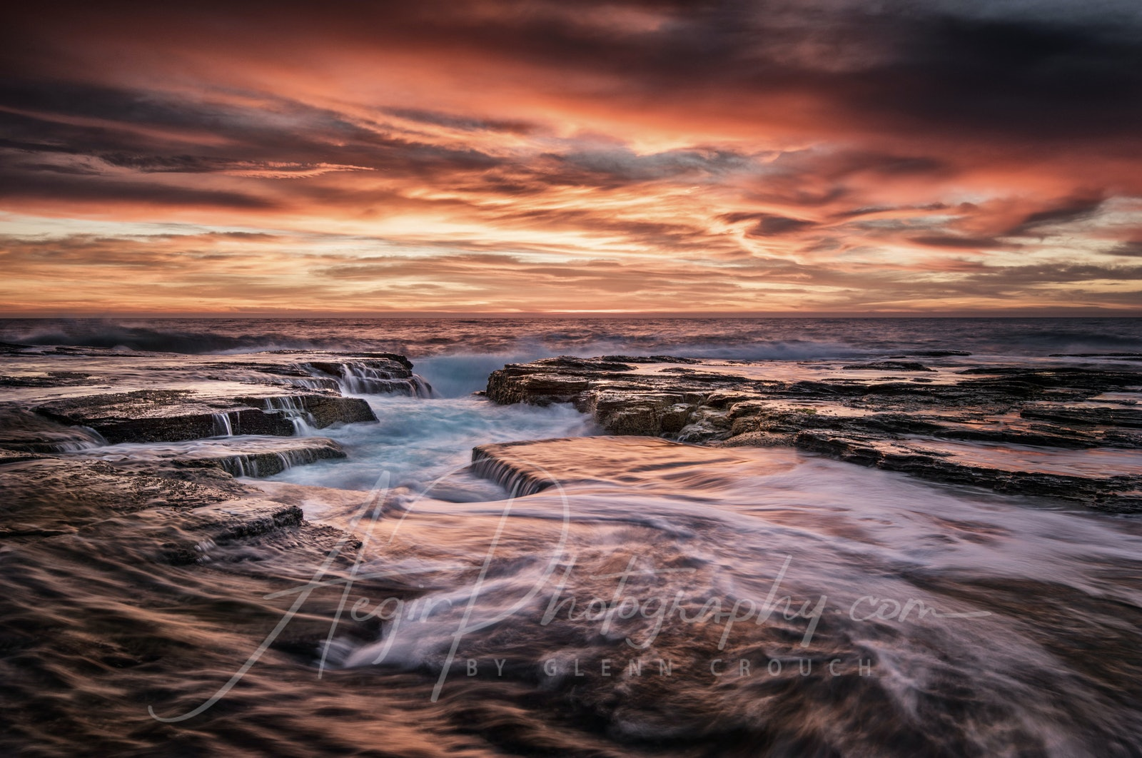 Orange Channel - A colour bomb sunrise over the outer channel at North Narrabeen pool, on the northern beaches of Sydney