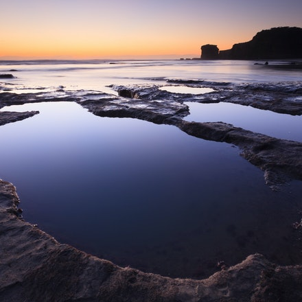 Tidal pools Muriwai - Twilights colours light up the seascape.