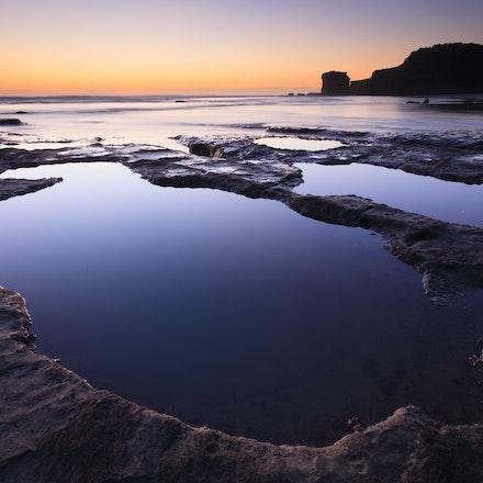 Tidal pools Muriwai - Twilights colours light up the seascape.