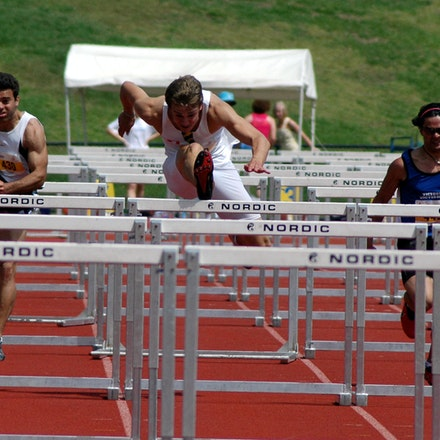 110mH - Justin Merlino from Sydney University clears a hurdle on the way to victory in the 110m hurdles at the 2007 Australian University Games on the...