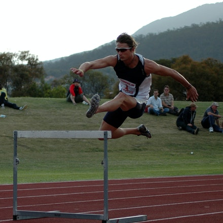 Brendan Cole - Brendan Cole clears the first barrier in the 400m hurdles at the 2008 Briggs Athletics Classic.