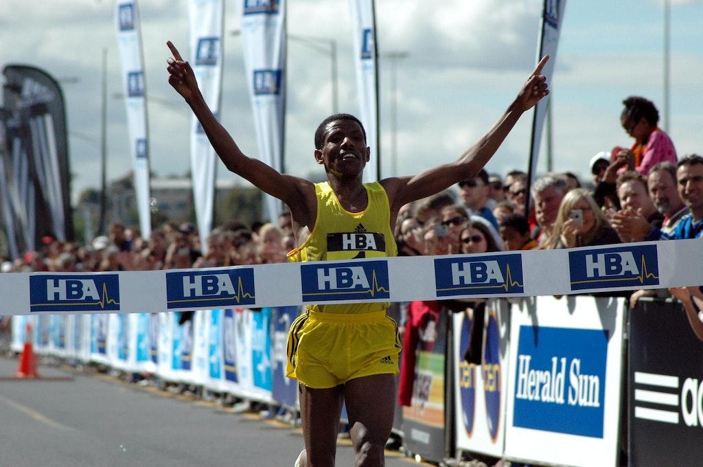 Haile Gebrselassie - Ethiopia's Haile Gebrselassie celebrates as he crosses the line as the inaugural winner of the Great Australian Run in Melbourne in...