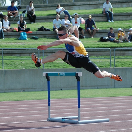 James Roff - James Roff clears the first hurdle in the 400m hurdles at the 2008 NSW Championships.