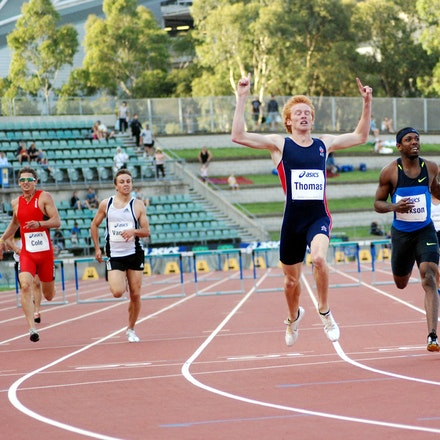 Tristan Thomas - Tristan Thomas celebrates as he crosses the line in a personal best of 48.86 seconds to win the 400m hurdles at the 2009 Sydney Track...