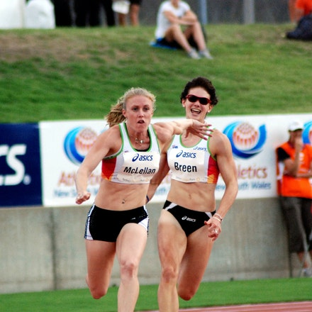 Breen to McLellan - Melissa Breen and Sally McLellan at the first change of the 4x100m at the 2009 Sydney Track Classic. The Australian quartet which also...